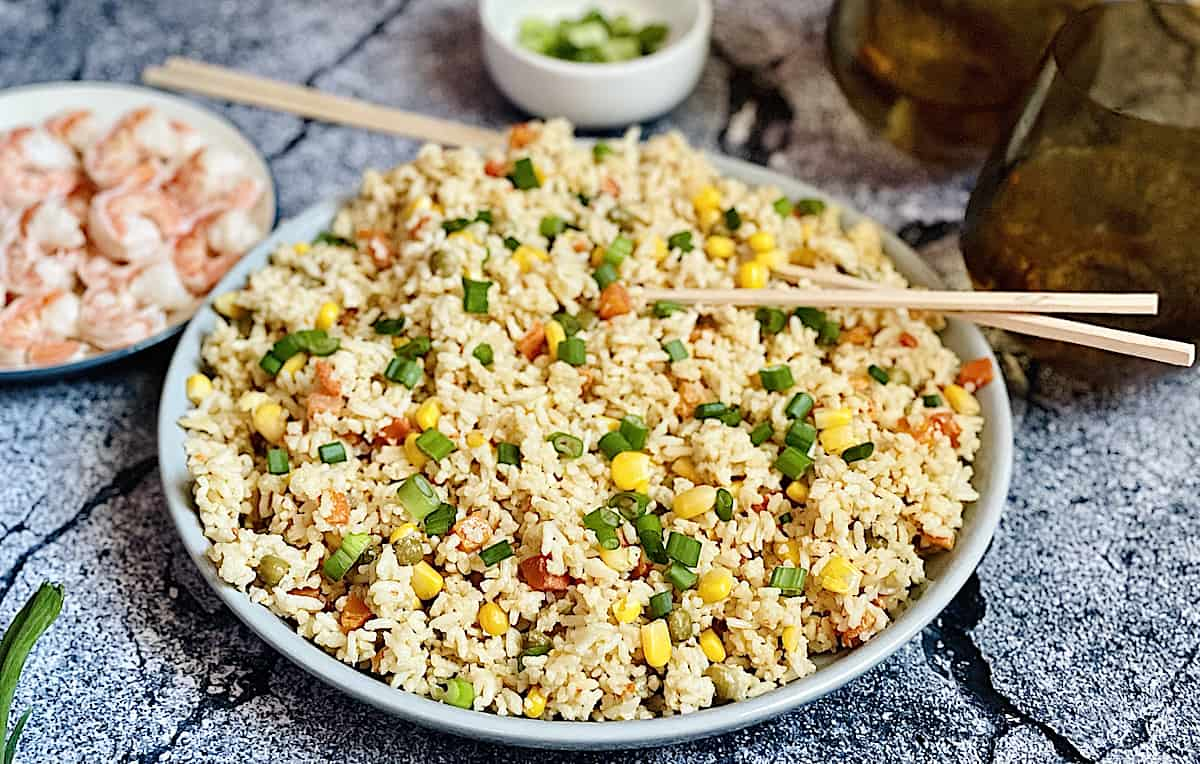 Instant Pot fried rice on a grey plate served with shrimp