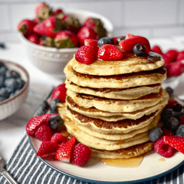 oat milk pancakes topped with fruit and syrup