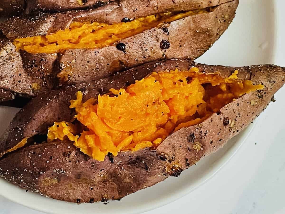 close up of 1 sweet potato on a white plate