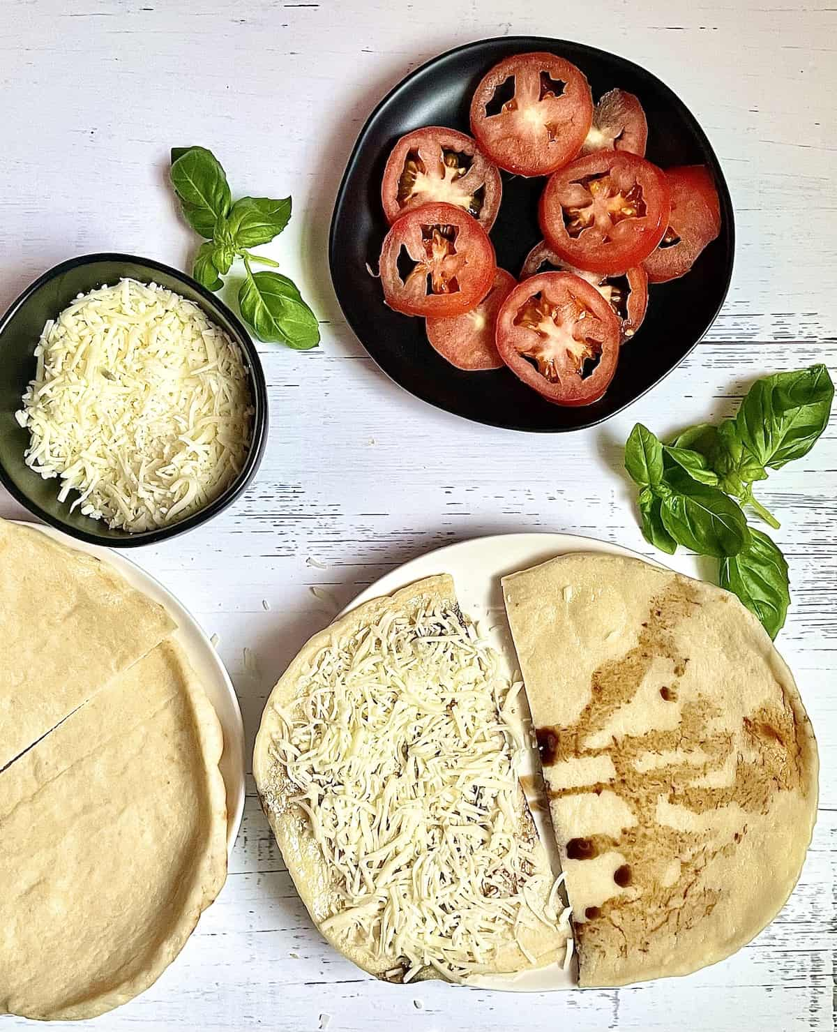 naan bread drizzled with balsamic and covered with mozzarella cheese