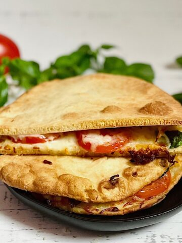 air fryer toasted sandwich with tomatoes, basil and mozzarella cheese