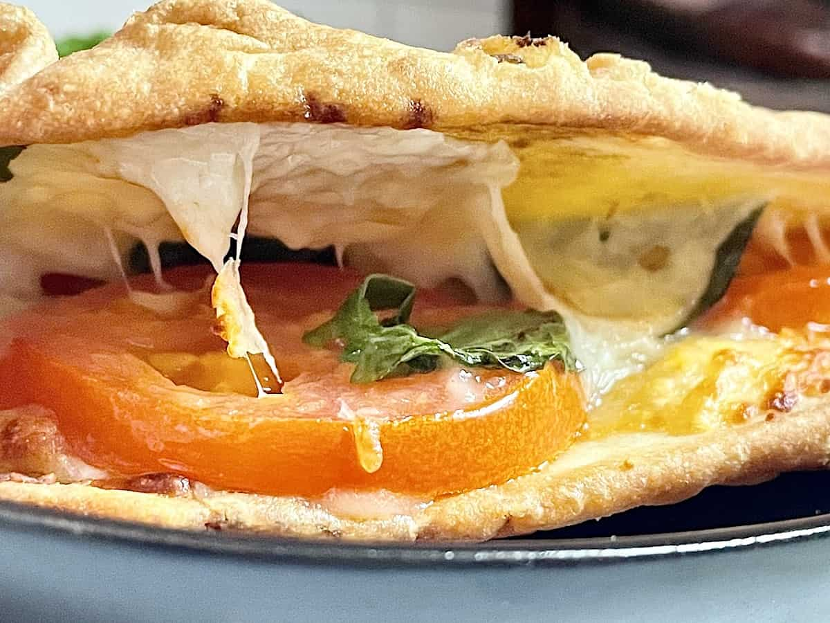 insides of a tomato basil and mozzarella cheese air fried sandwich