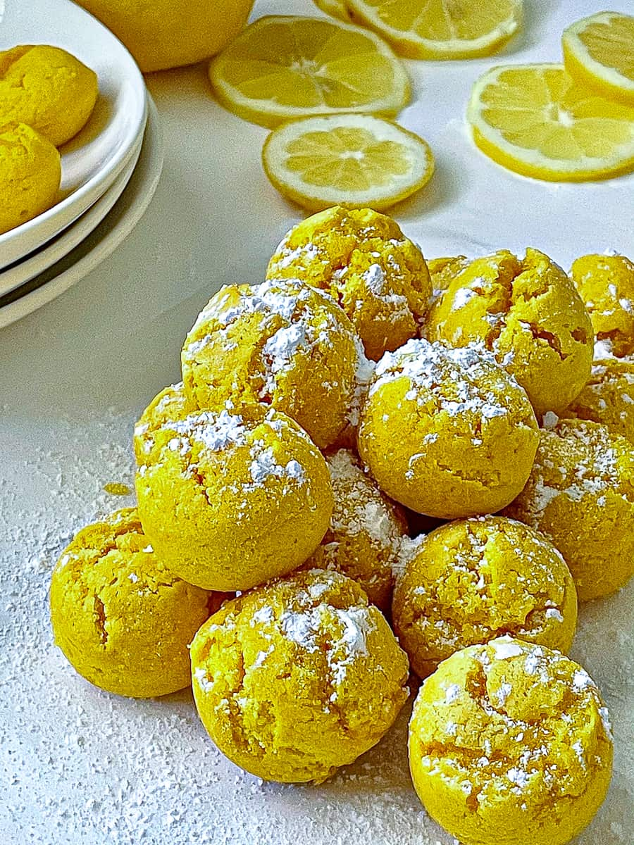 pile of lemon drop cookies coated with powdered sugar