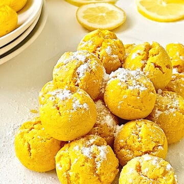 air fryer lemon drop cookies coated with powdered sugar in a pile
