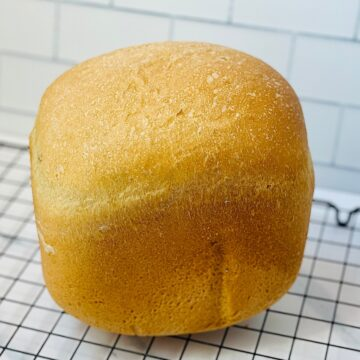 bread machine white bread on a cooling rack