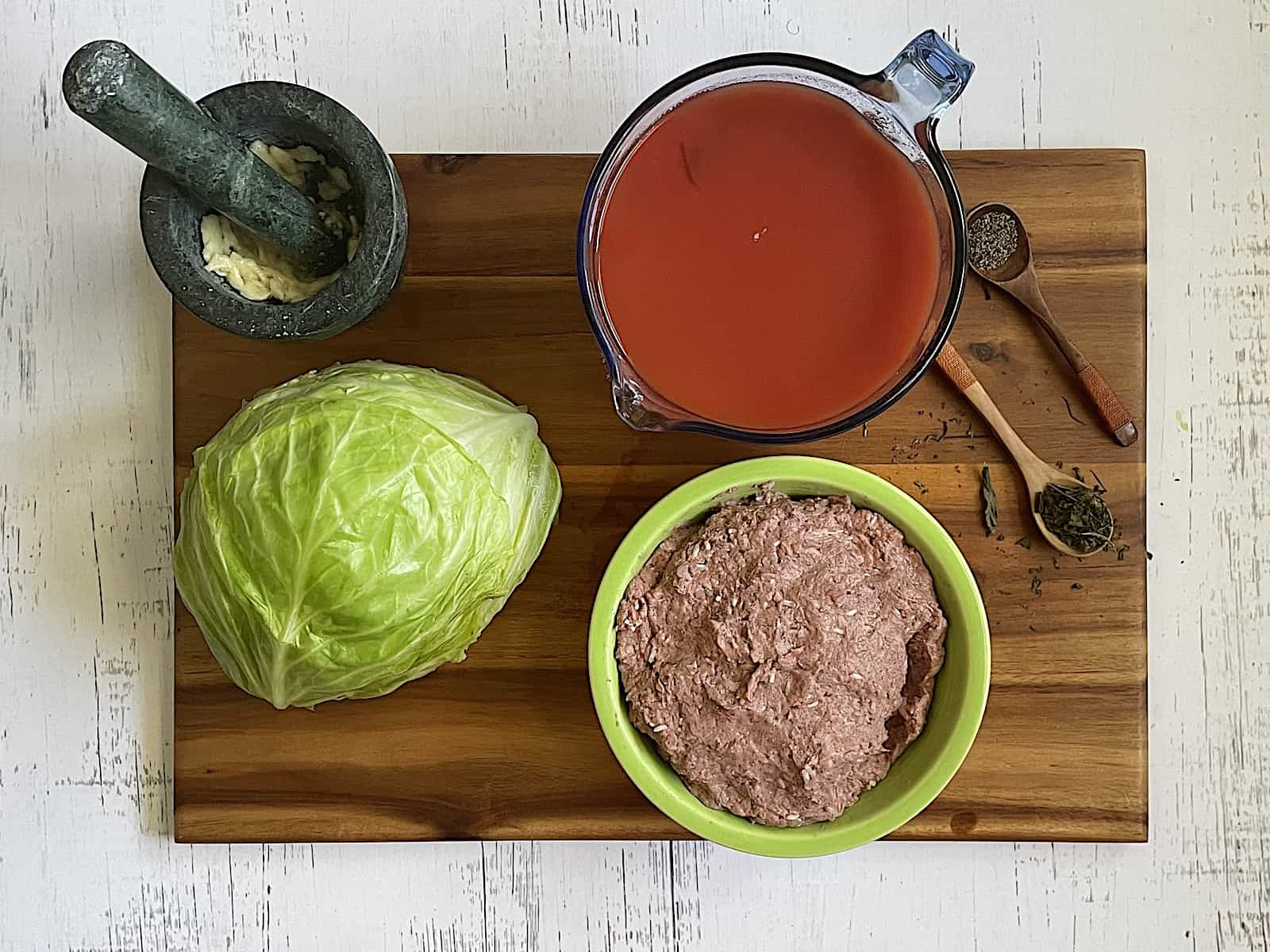 instant pot cabbage rolls ingredients on a cutting board