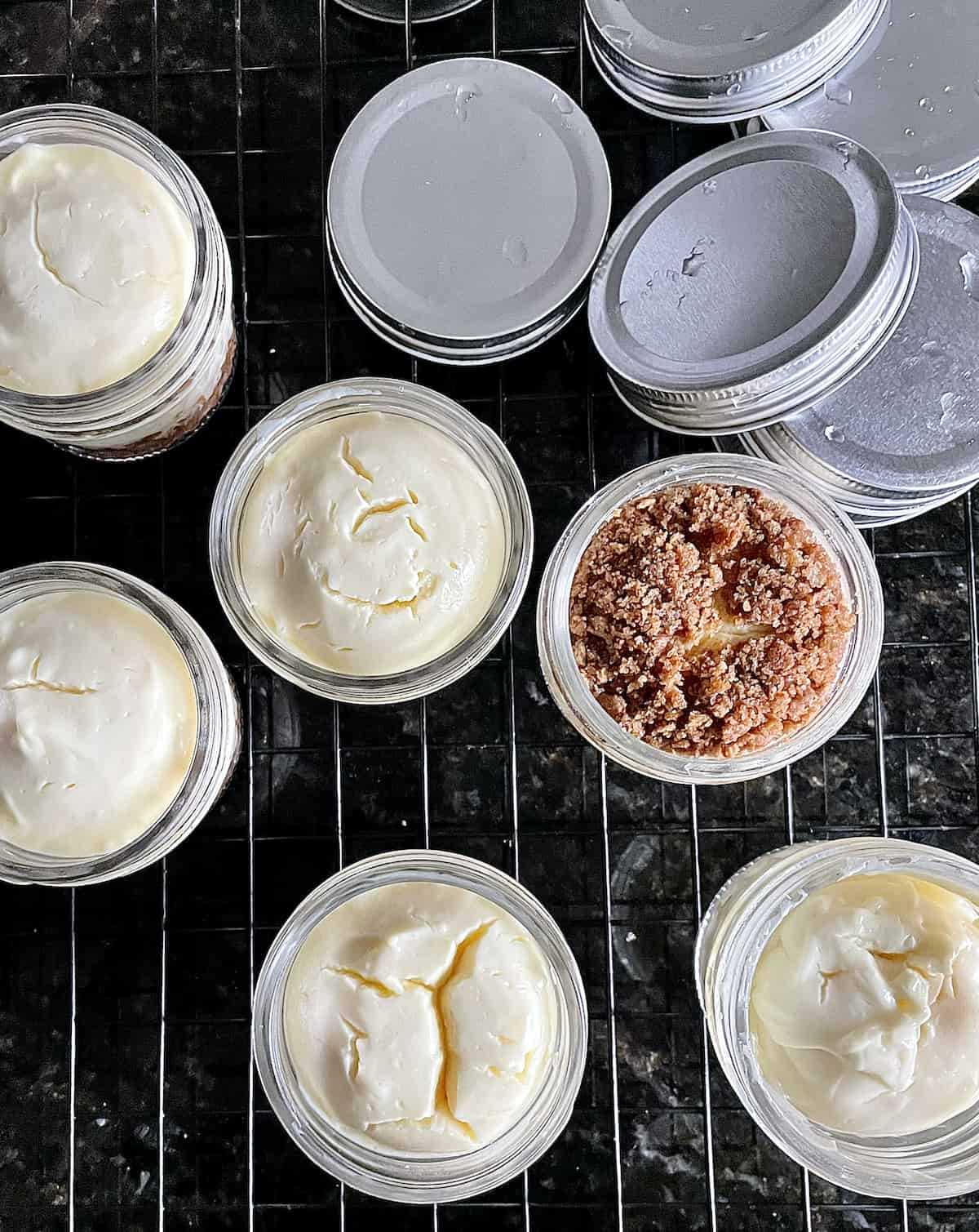mini instant pot cheesecakes in jars on a cooling rack