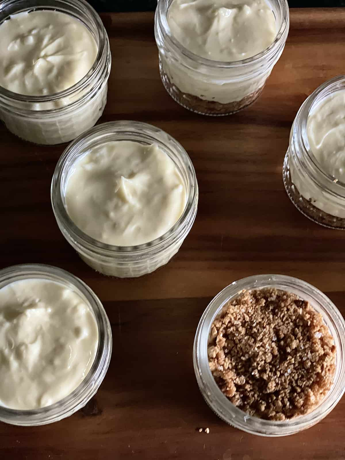 uncooked pressure cooker mini cheesecakes on a cutting board