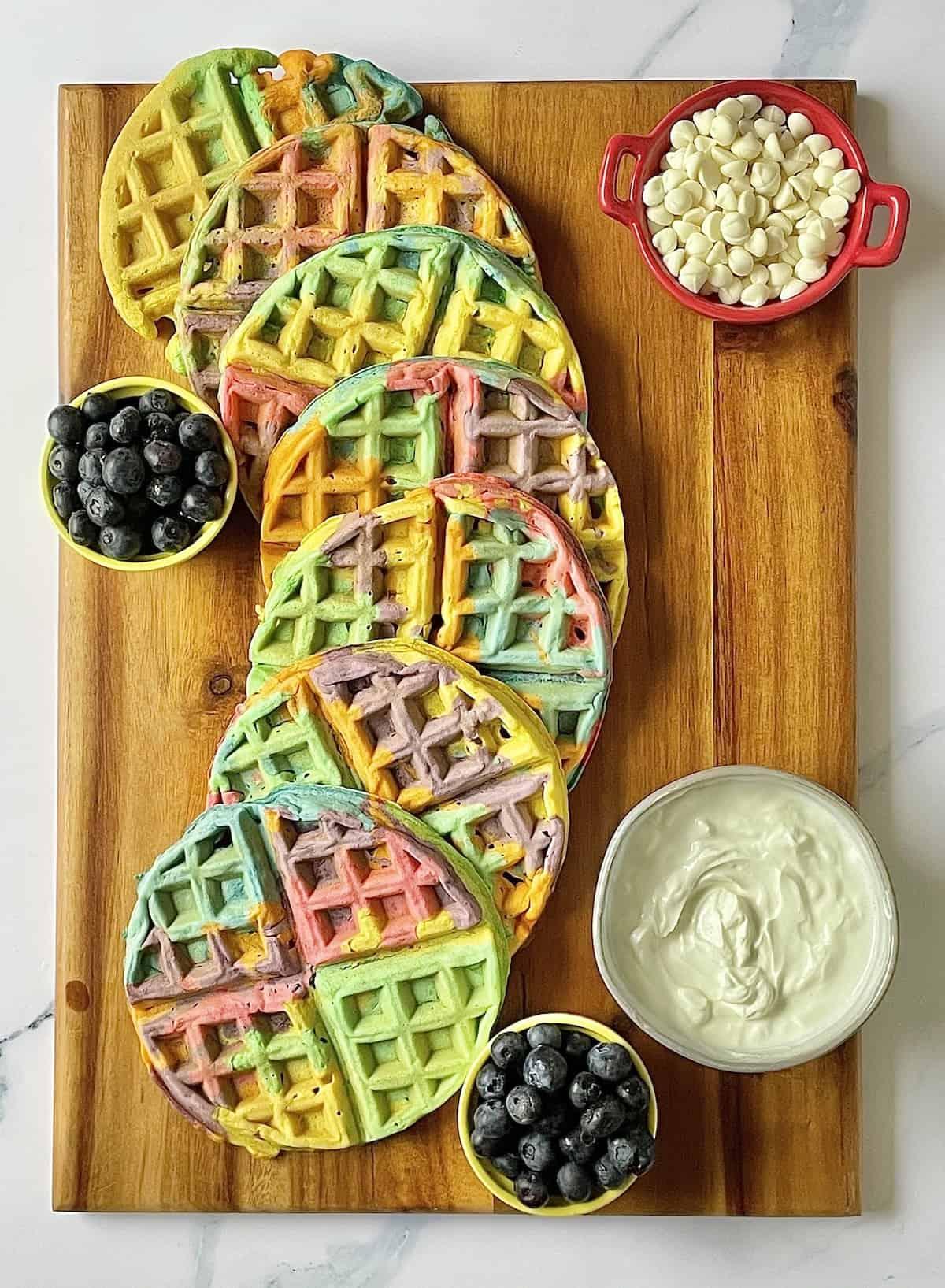 waffles, fruit, and yogurt on a charcuterie board