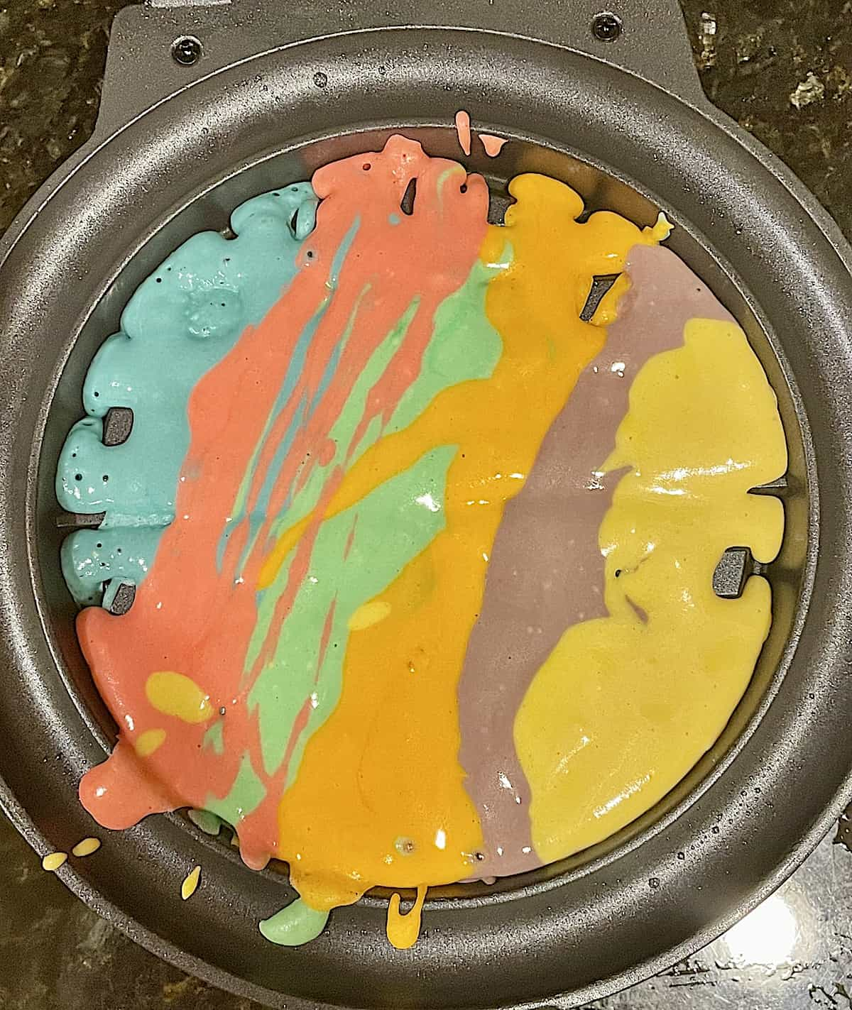 rainbow batter in a waffle maker
