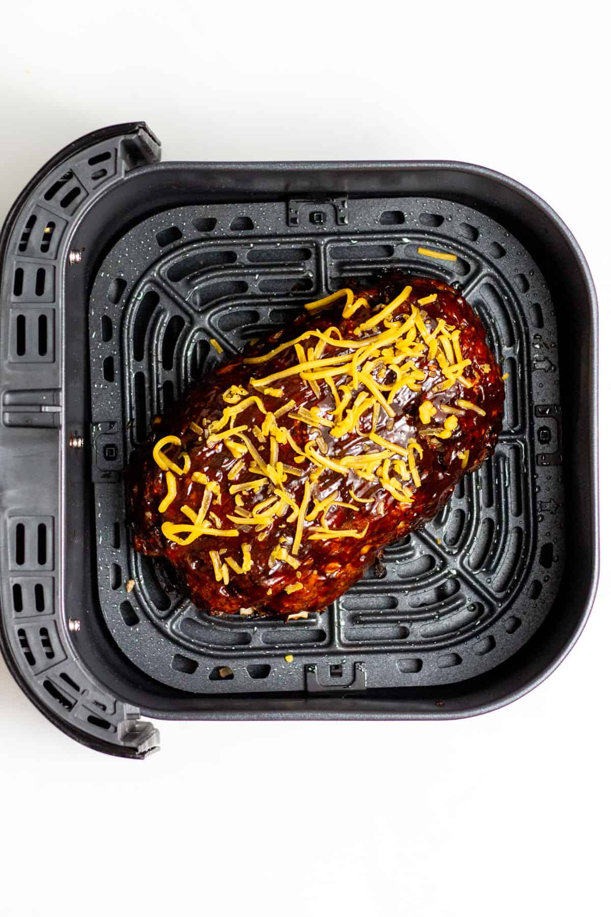meatloaf brushed with glaze and topped with cheddar cheese