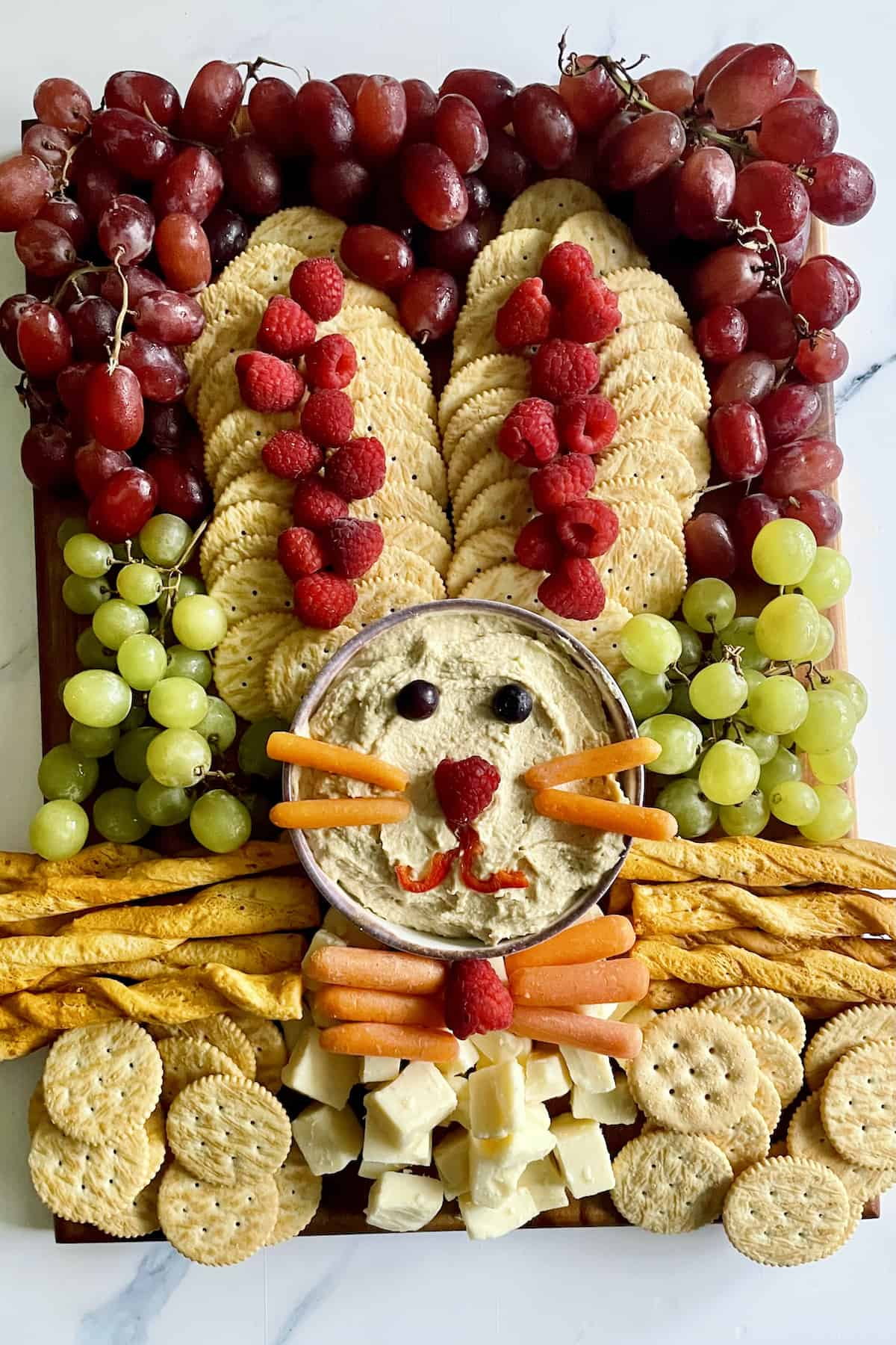 Easter Bunny platter shaped into the bunny with fruits, veggies, crackers, and cheese