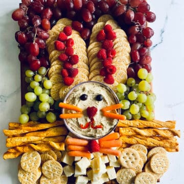 Easter bunny platter with fruits, veggies, cheese, and crackers