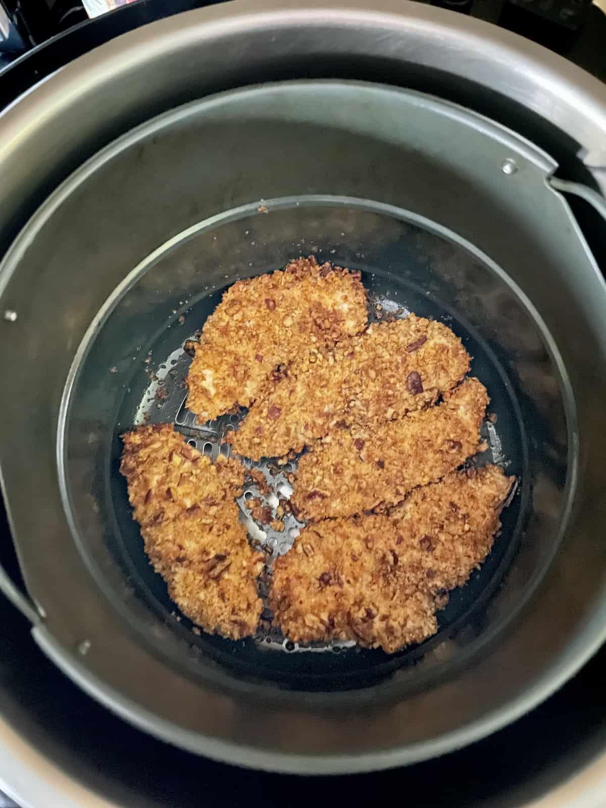 air fryer pecan crusted chicken in the basket