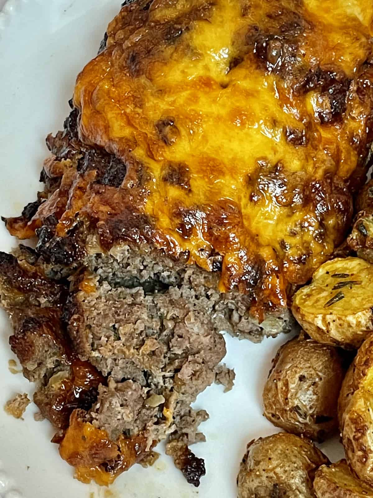 air fryer barbecue cheddar meatloaf sliced on a plate