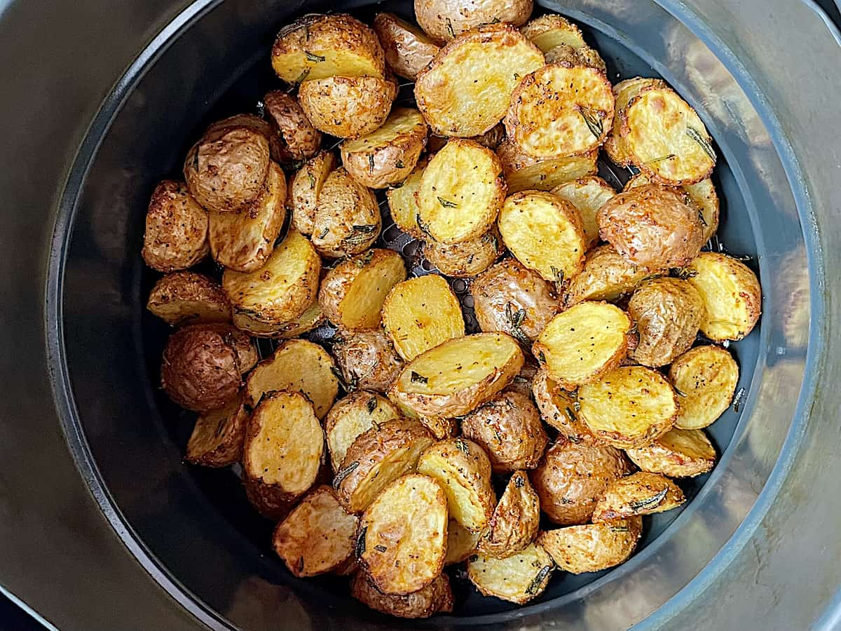 cooked baby potatoes in an air fryer basket