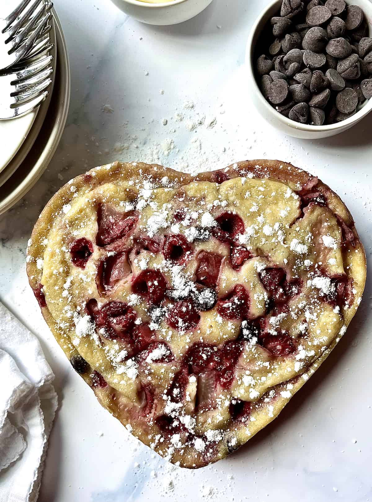 instant pot pancake in a heart shape with fruit