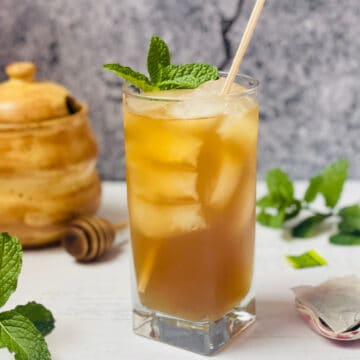 instant pot iced green tea in a cup with mint leaves
