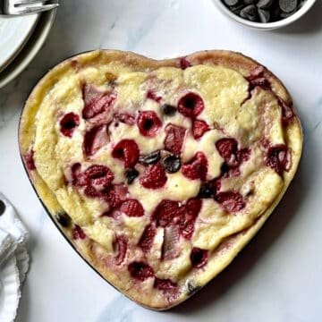 instant pot pancake with fruit and chocolate in a heart shape