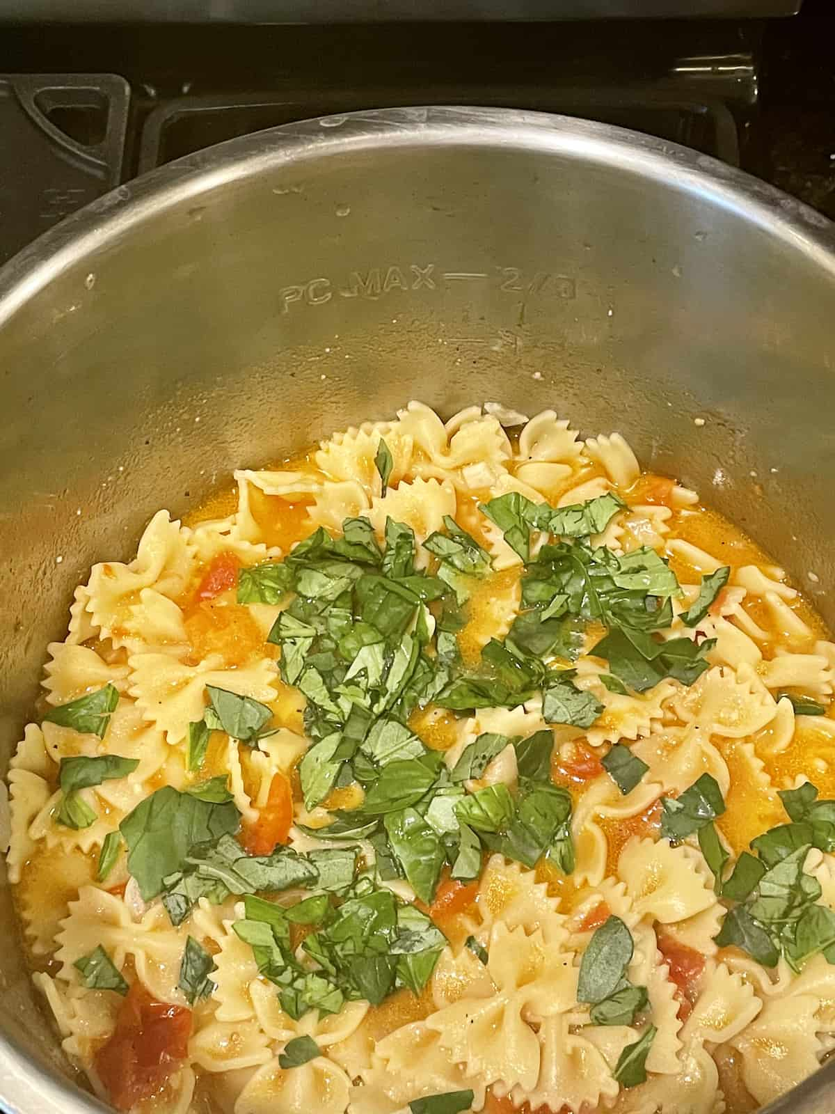 pasta and and fresh tomato sauce topped with fresh basil