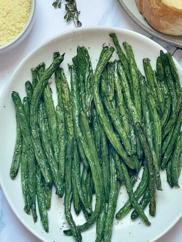 air fried green beans on a white plate