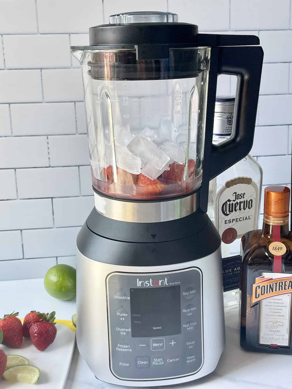 strawberries, alcohol, and ice in a blender