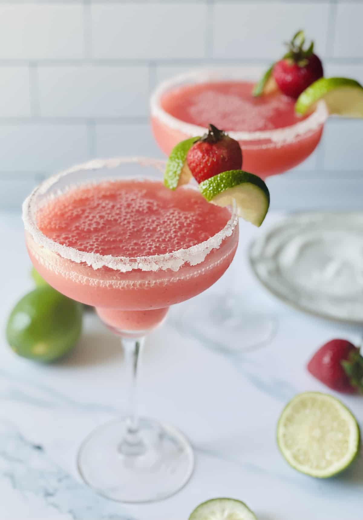 pink margaritas in sugar lined glasses
