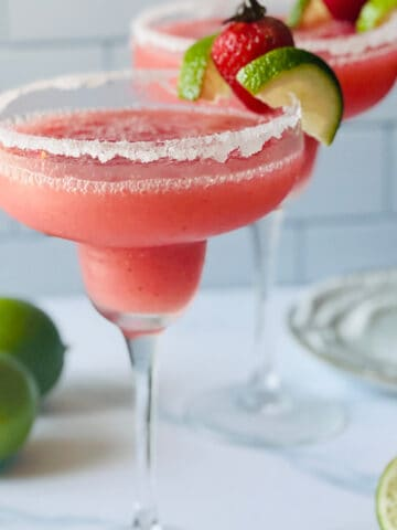 frozen strawberry margaritas garnished with lime