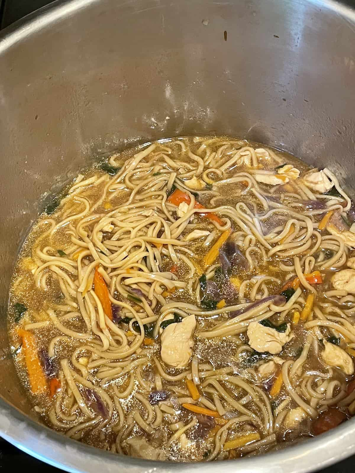 instant pot chicken lo mein cooked in an inner pot