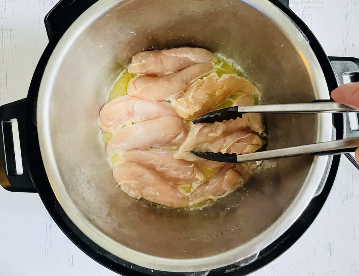 chicken breasts in butter in a pressure cooker