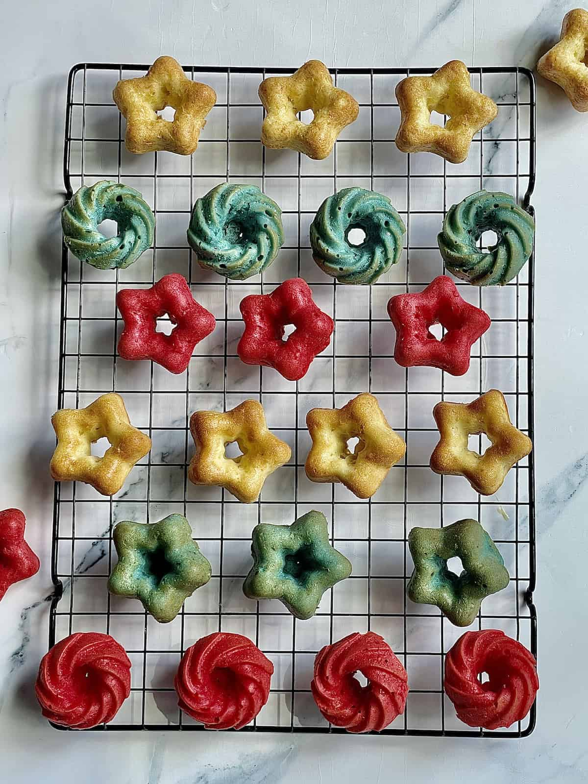 star shaped red white and blue mini cakes on a cooling rack