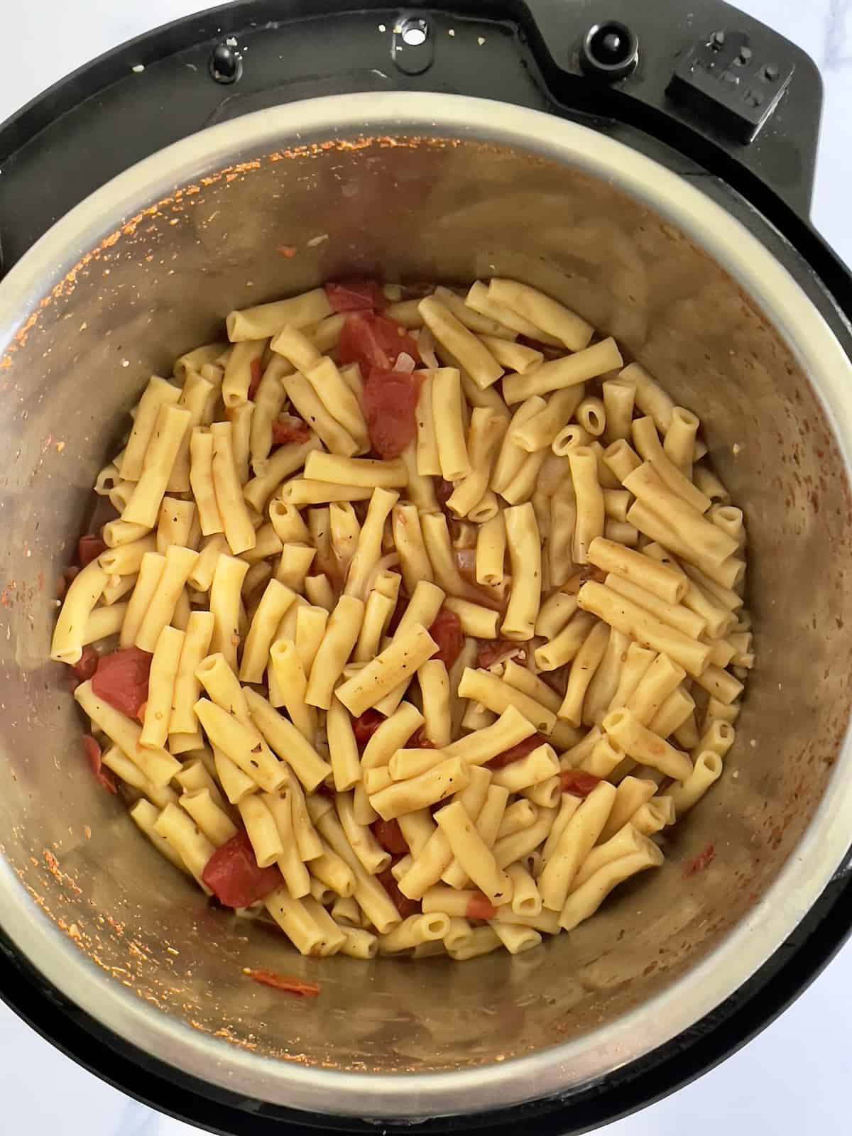 cooked pasta and tomatoes in the inner pot