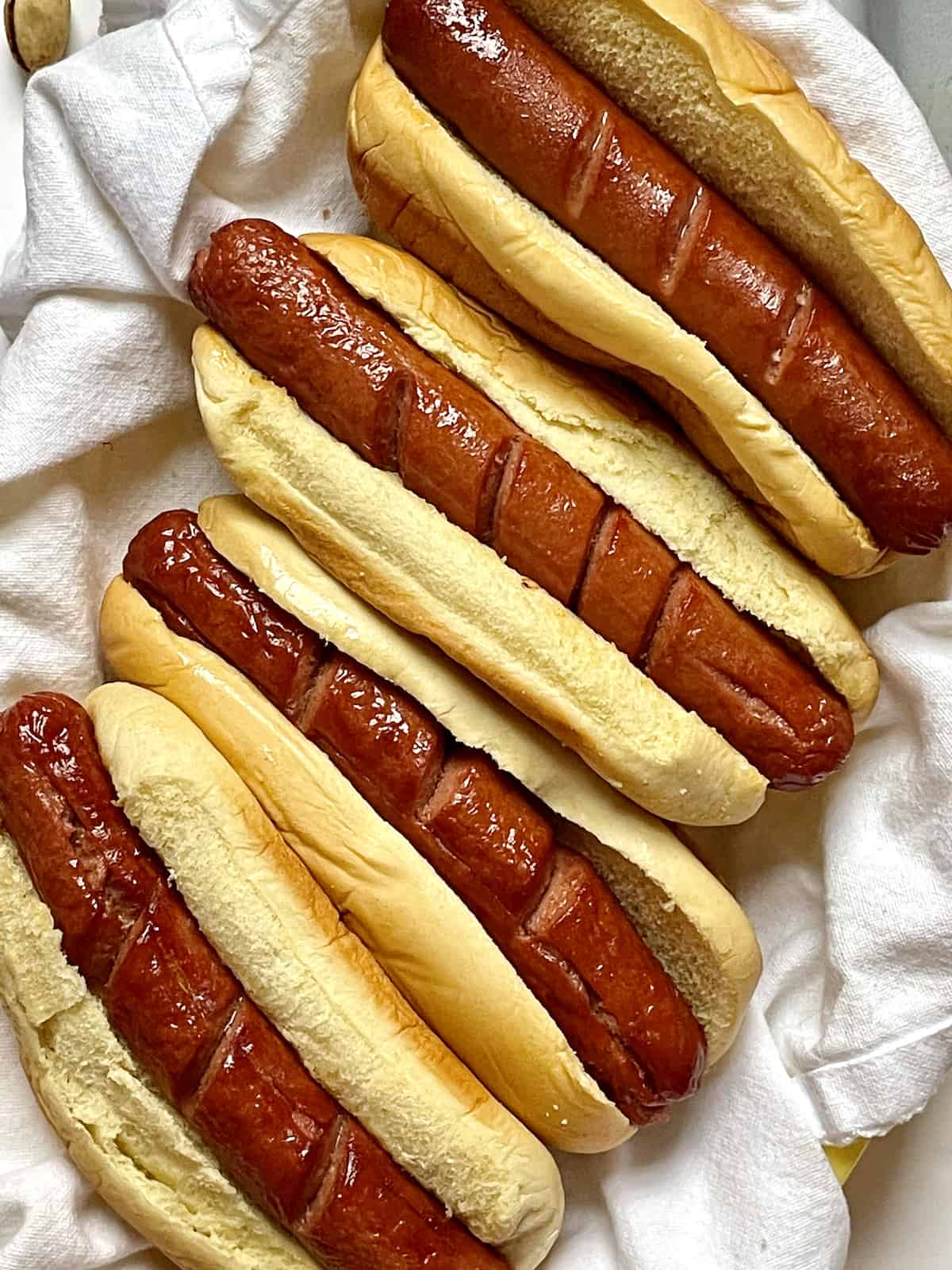 close up of air fried hot dogs in buns