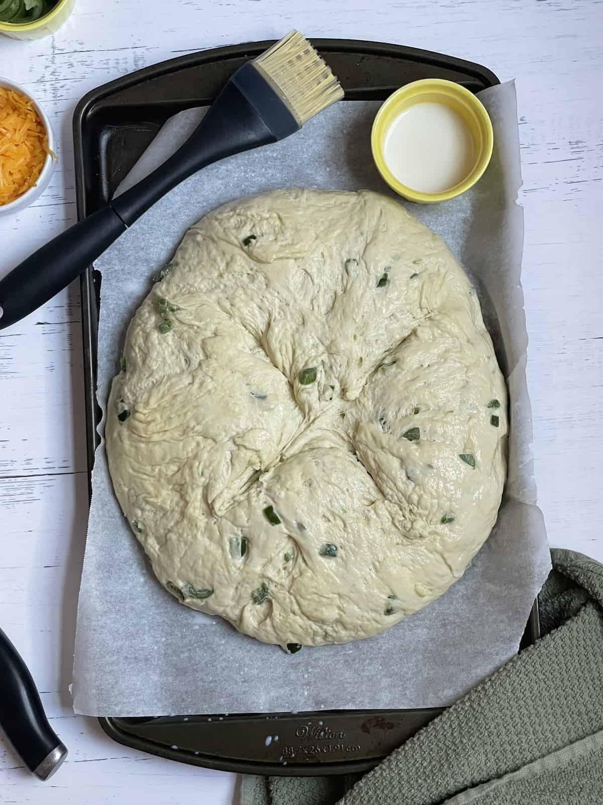 dough resting on a baking sheet