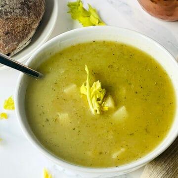 instant pot celery soup in a white bowl