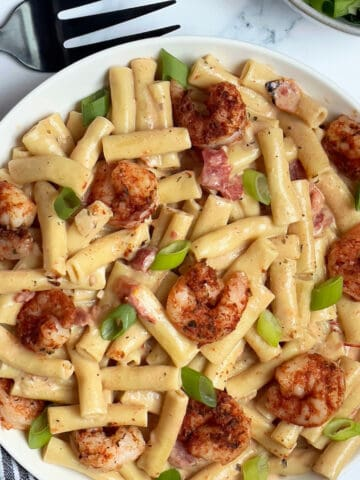 instant pot creamy cajun pasta and shrimp in a white bowl