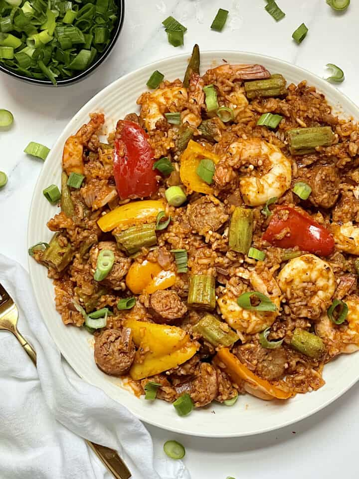 instant pot jambalaya in a white dish topped with scallions