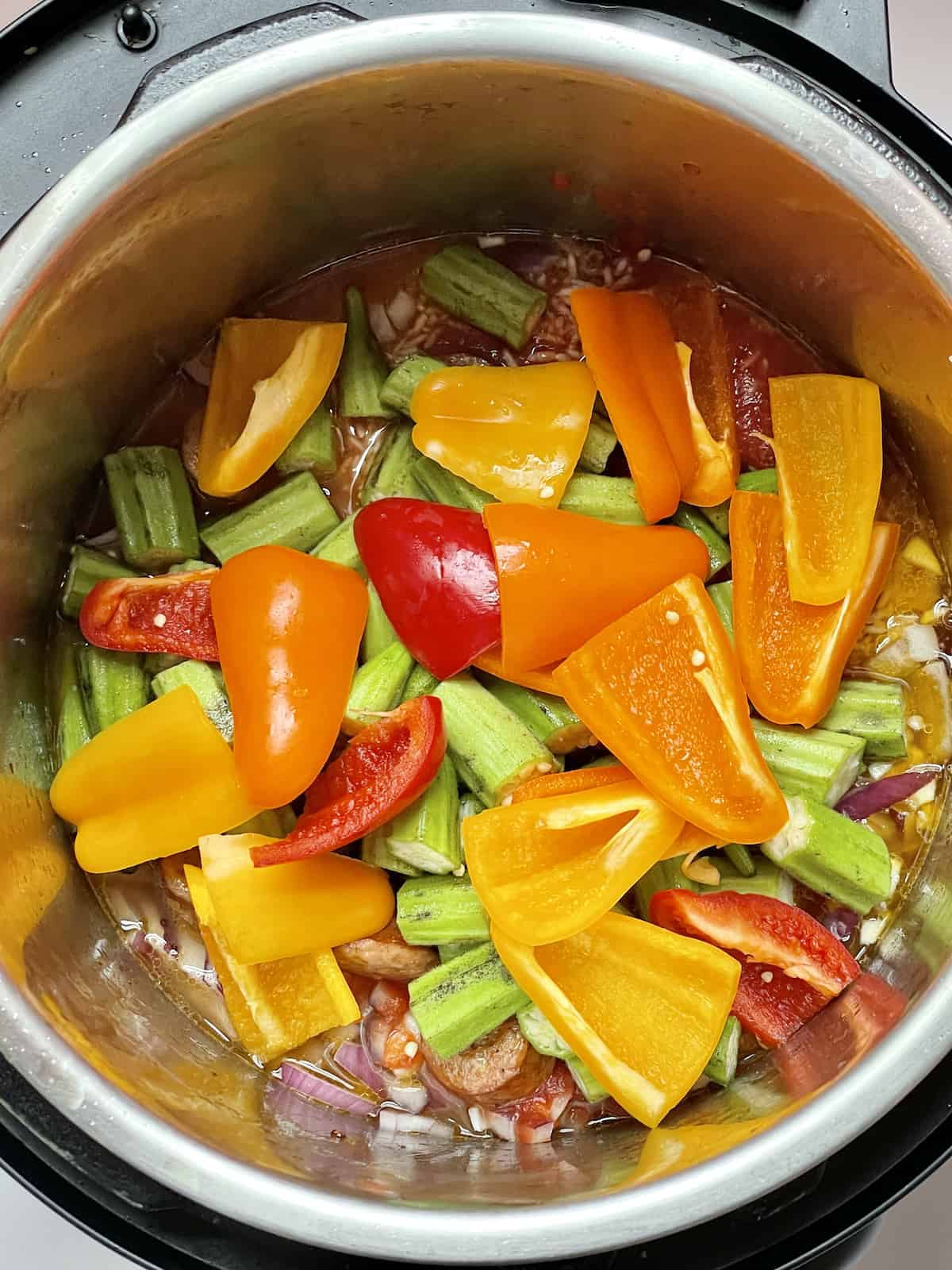peppers, okra, and other ingredients in the instant pot