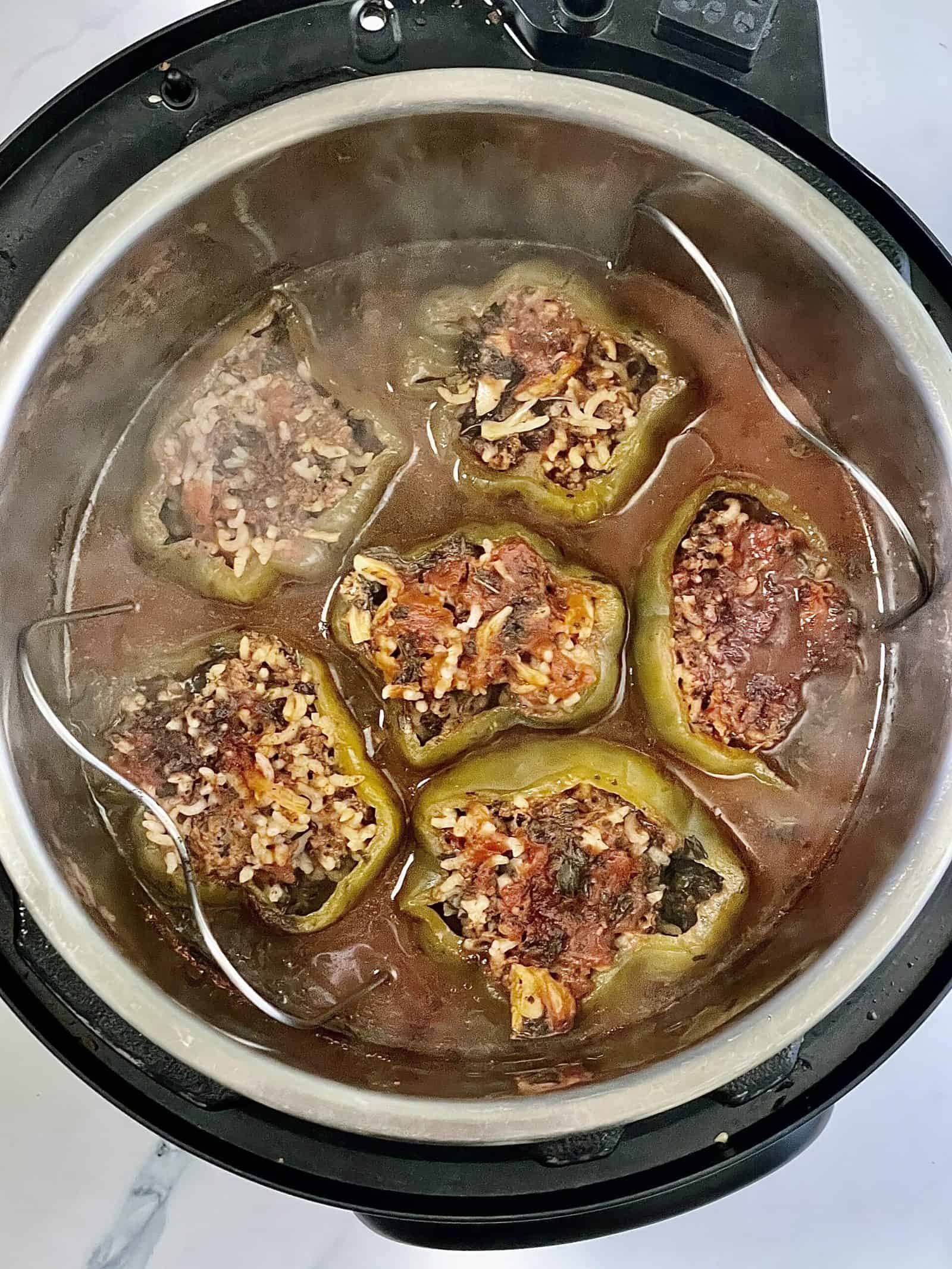 stuffed belle peppers after being cooked inside the instant pot