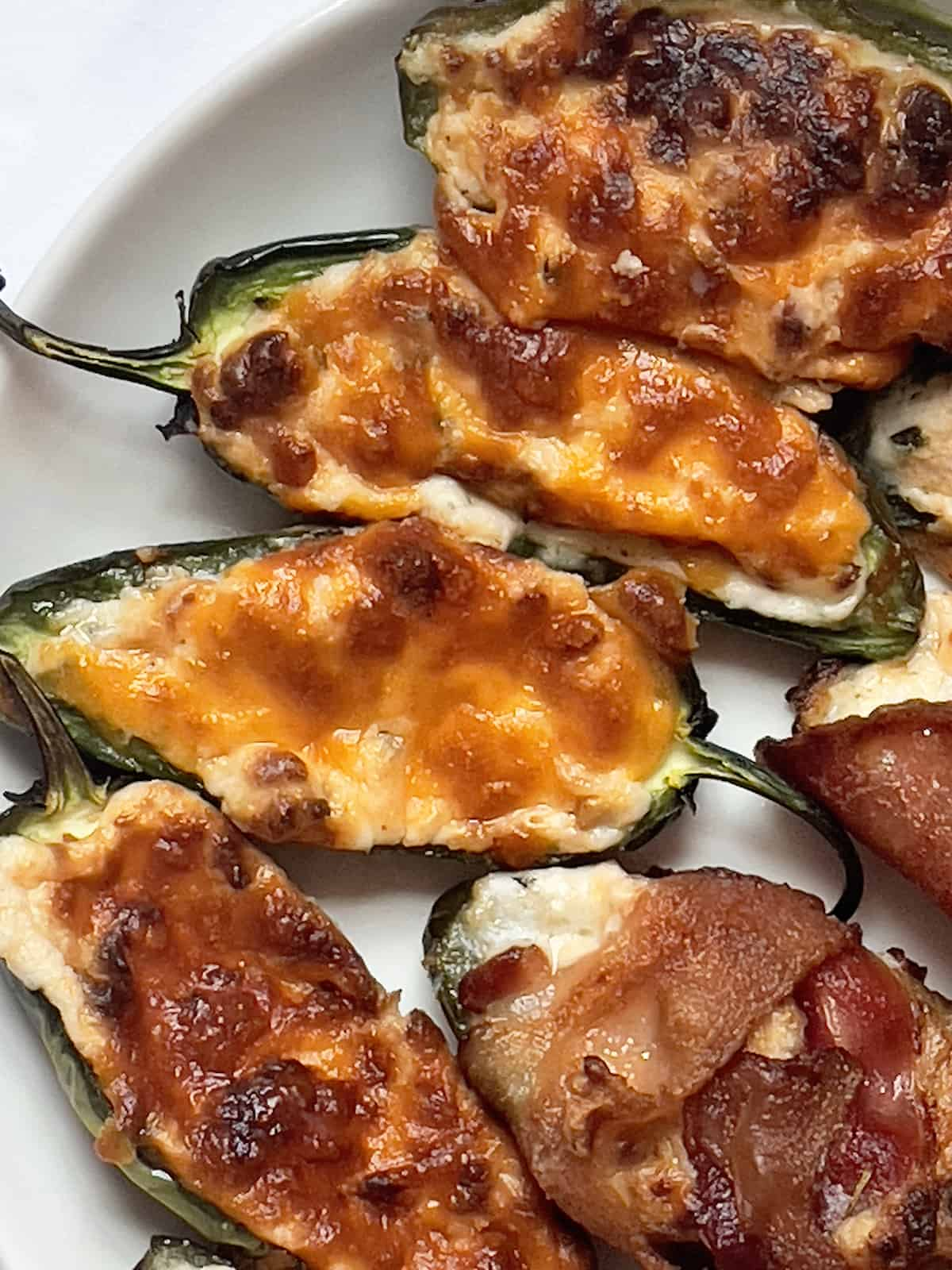 air fried jalapeno poppers on a white plate