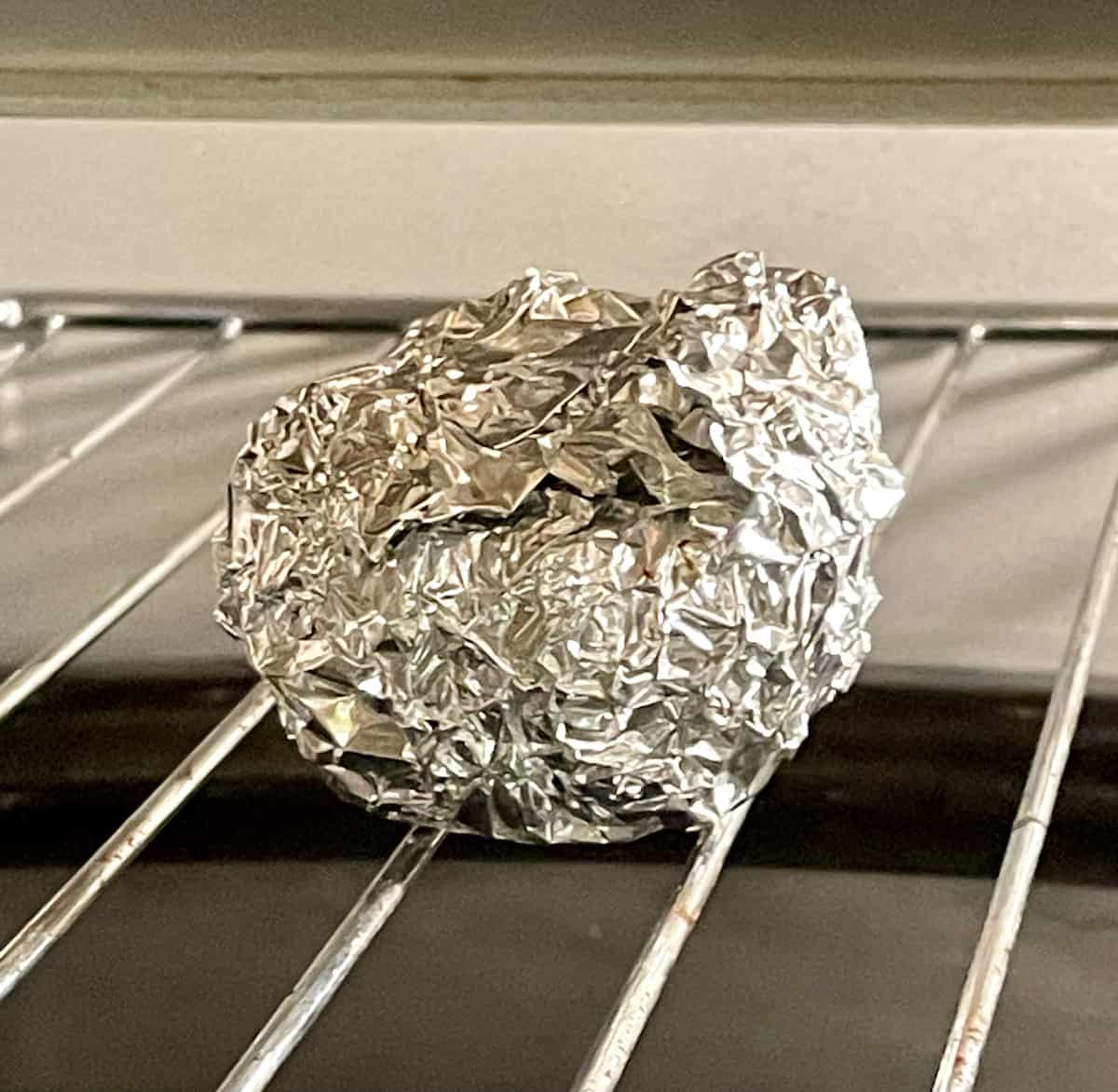 foiled wrapped garlic bulb in an air fryer