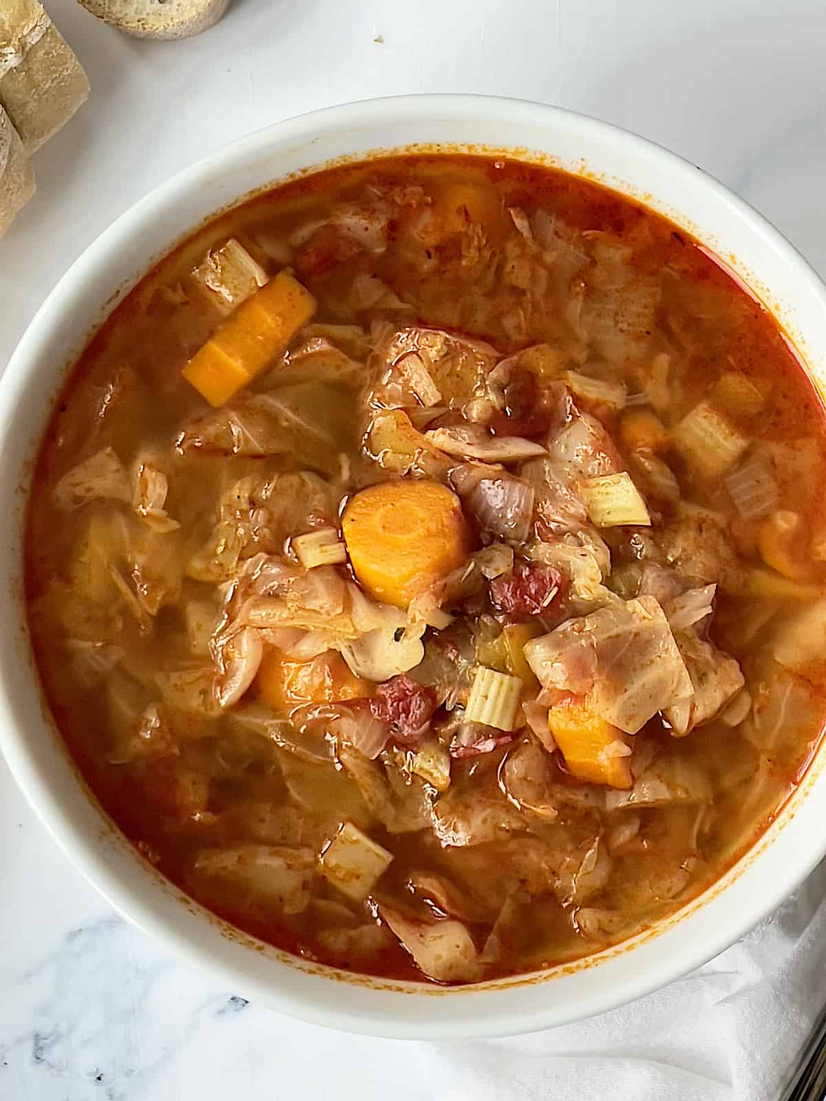 instant pot cabbage soup in a white bowl
