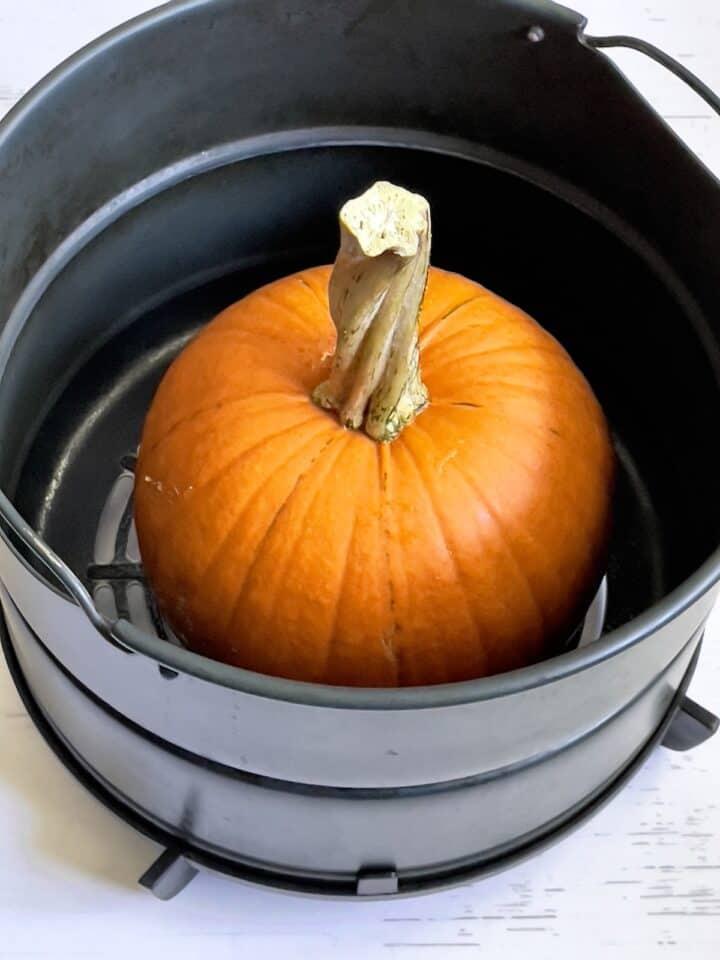 whole pumpkin in an air fryer basket