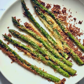 air fried parmesan asparagus on a white plate