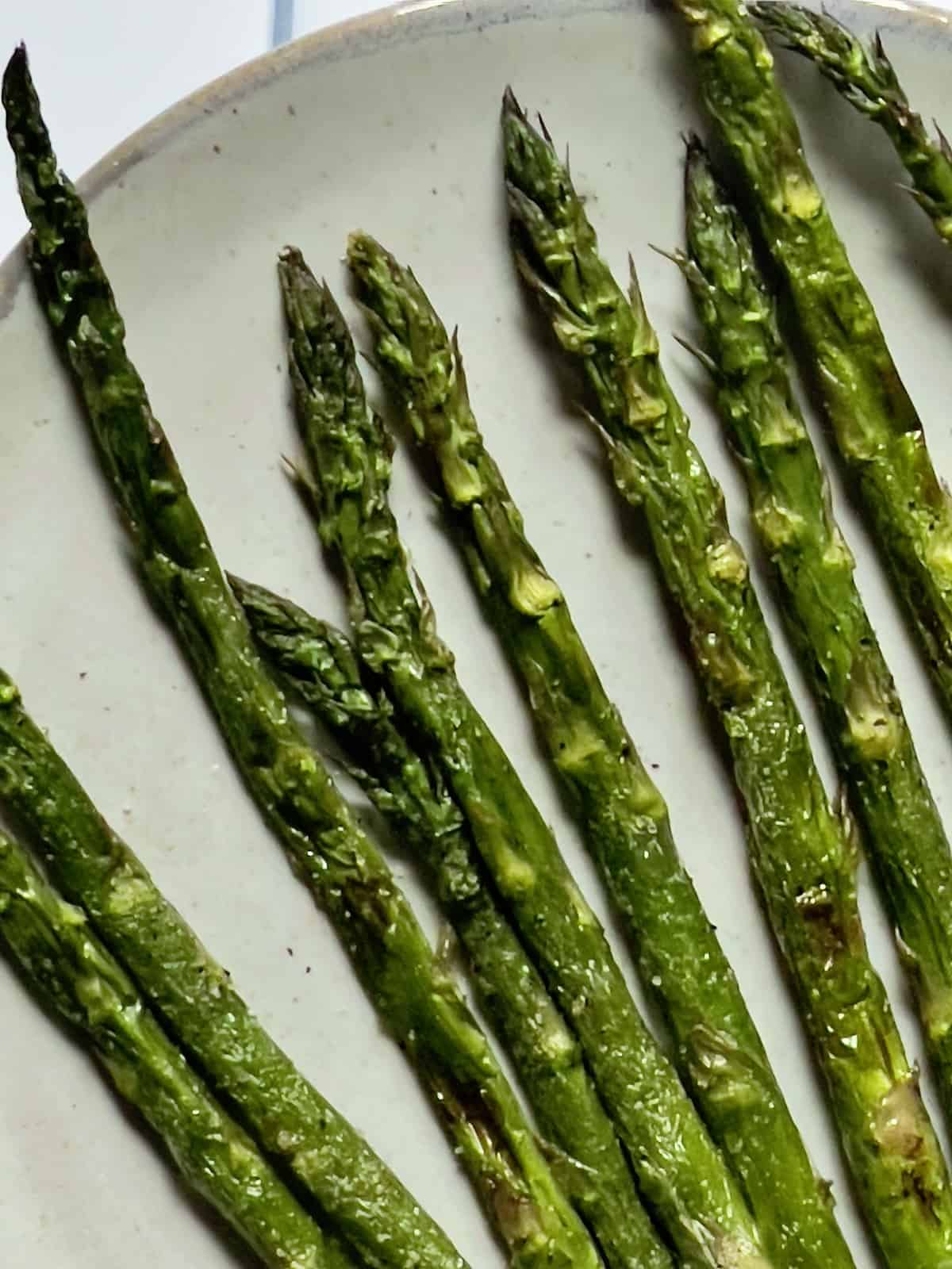 air fried asparagus on a white plate
