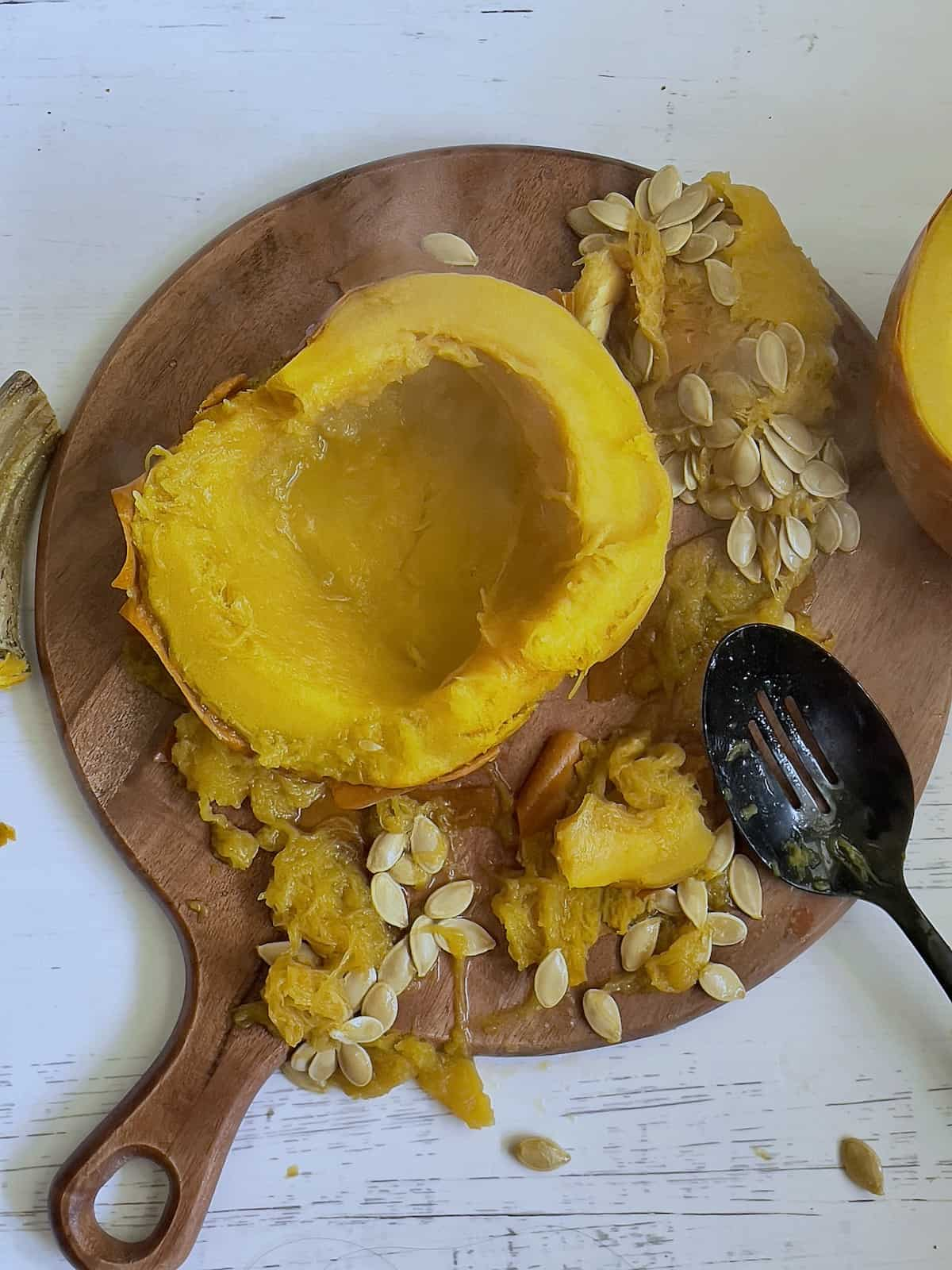 sliced pumpkin with the seeds scooped out