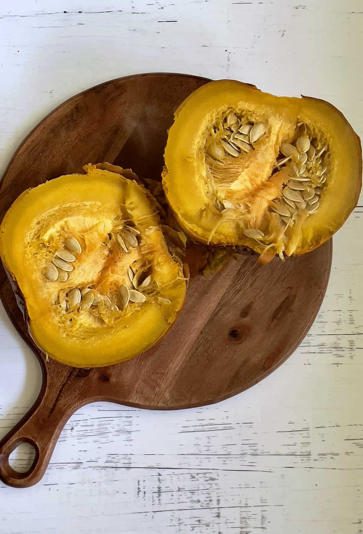 cut pumpkin on a chopping board