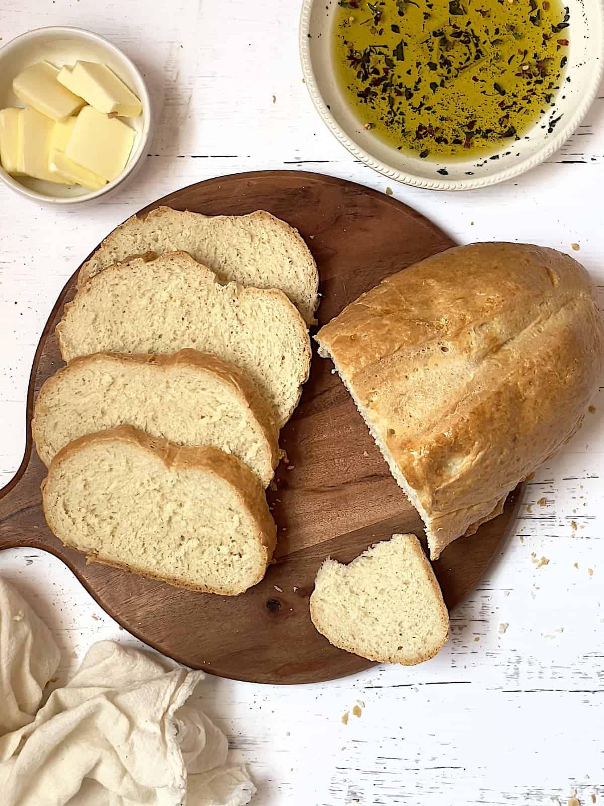sliced bread machine Italian bread on a cutting board