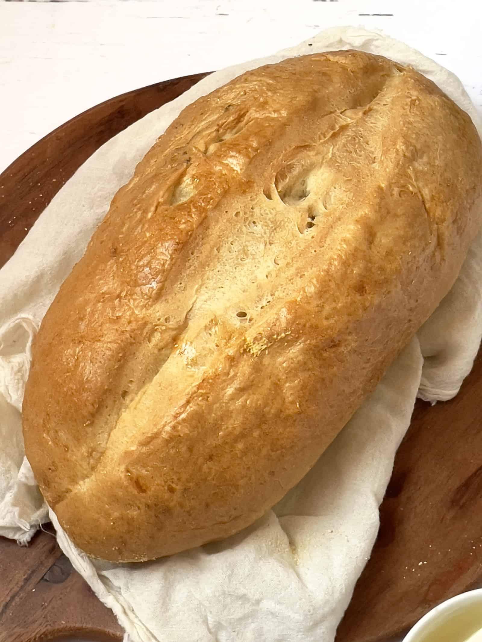 loaf of italian bread on a cutting board