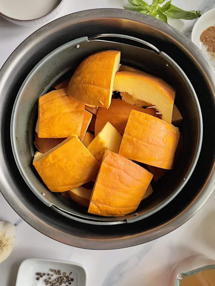 pumpkin chunks in an air fryer basket